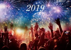 2019 happy new year with hands up and fireworks