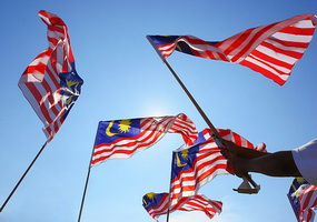 malaysian flag flying in blue sky