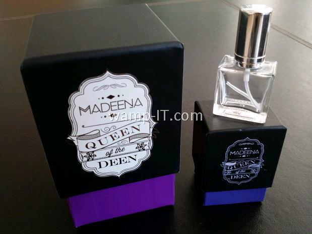 perfume bottle and purple box