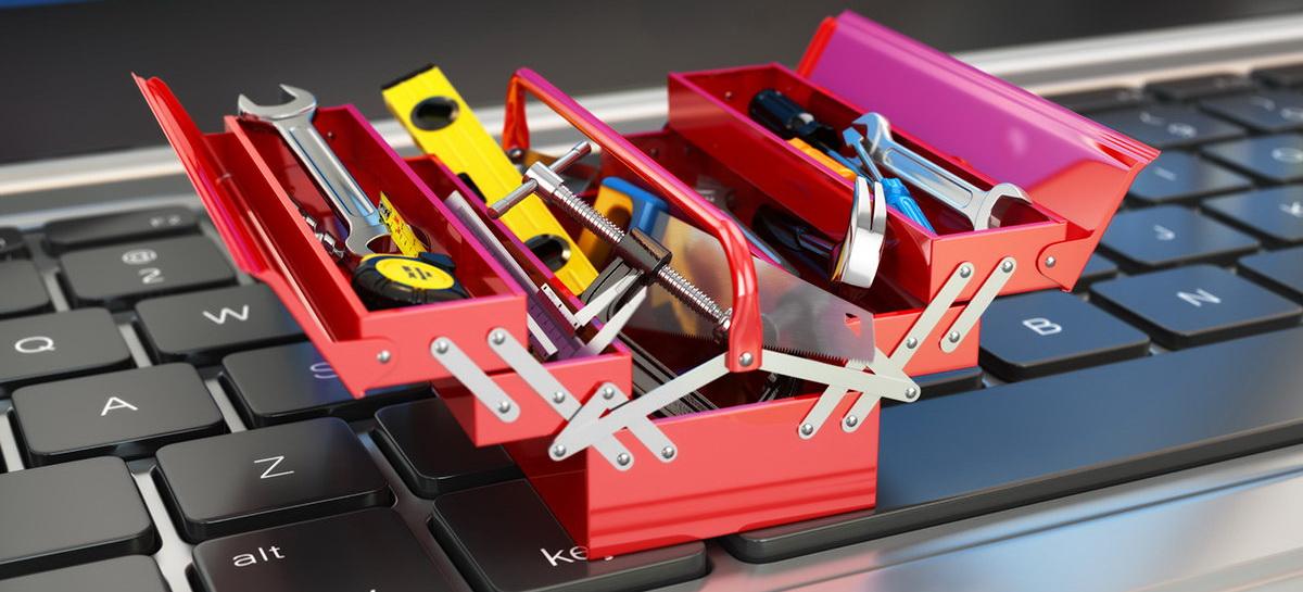 tools tiny toolbox toolkit on laptop keyboard